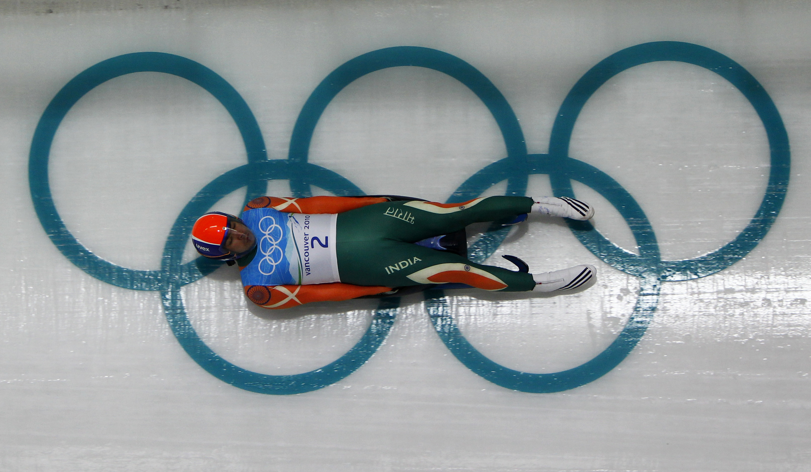 India's K.P. Keshavan speeds down the track during a training run for the men's singles luge in preparation for the Vancouver 2010 Winter Olympics in Whistler